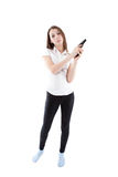 Young girl holding a pistol Stock Photography