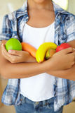 Young girl holding plastic fruit and vegetables Stock Images