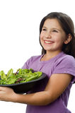 Young girl holding plate with salad Stock Photos
