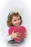 Young girl holding a plush pink heart Stock Photo