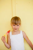 Young girl holding with popsicle Stock Photos