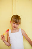 Young girl holding with popsicle Stock Images