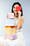 Young girl holding present boxes Royalty Free Stock Image