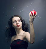 young girl holding a red apple Royalty Free Stock Photos