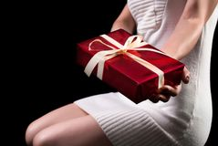 Young girl holding red gift box with bow stock images