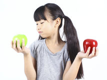 Young girl holding red and green apple Stock Image