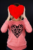 Young girl holding a red heart Stock Image