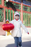 Young girl holding red lantern Royalty Free Stock Photos