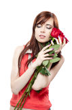 Young girl holding red roses isolated on white Royalty Free Stock Photos