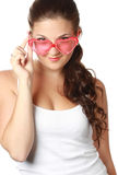 Young girl is holding red sunglasses Royalty Free Stock Image