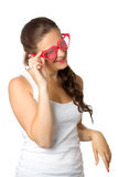 Young girl is holding red sunglasses. Glamour portrait of young girl with red lips and sunglasses isolated over white Stock Photography