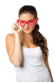 Young girl is holding red sunglasses. Glamour portrait of young girl with red lips and sunglasses isolated over white Royalty Free Stock Image