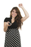 Young girl holding remote control Stock Images