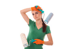 Young girl holding rollers for painting walls Stock Photos