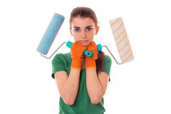 Young girl holding rollers for painting walls isolated on white background Royalty Free Stock Images
