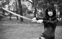 Young girl holding samurai sword. Stock Image
