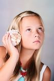 Young girl holding a seashell Royalty Free Stock Images