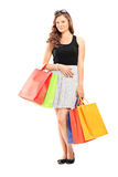 Young girl holding shopping bags Stock Photo