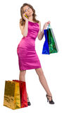 Young girl holding shopping bags and talking on Royalty Free Stock Photo