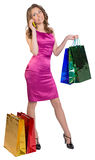 Young girl holding shopping bags and talking on. The phone Royalty Free Stock Photography