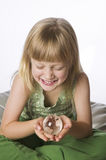 Young girl holding a small globe Stock Photography