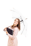 Young girl holding some books and an umbrella. Isolated on white background Royalty Free Stock Images