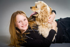 Young girl holding spaniel Stock Photos
