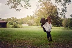 Young girl hugging stuffed bear on farm Royalty Free Stock Image