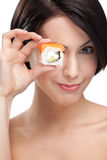 Young girl holding sushi Stock Photography
