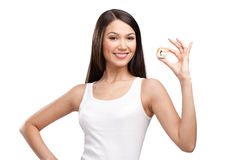 Young girl holding sushi and smiling Royalty Free Stock Images