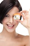 Young girl holding sushi and smiling Stock Photo