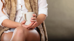 Young girl holding tea cup Stock Images
