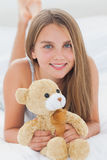 Young girl holding a teddy bear Stock Photo