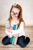 Young girl holding teddy bear Stock Photos