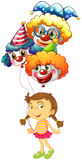 A young girl holding three clown balloons Stock Image