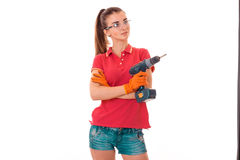 Young girl holding a tool for repair of apartments in goggles and red shirt Stock Image