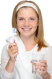 Young girl holding toothbrush glass water brushing Stock Photo