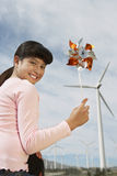 Young Girl Holding Toy Windmill Stock Image