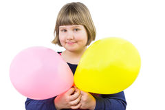 Young girl holding two balloons Stock Image