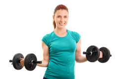 Young girl holding two barbells Stock Image