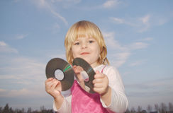 Young girl holding two cd's Stock Photo