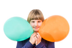 Young girl holding two colorful balloons Royalty Free Stock Images
