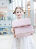 Young girl holding two gift wrapped boxes Royalty Free Stock Image