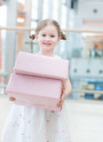 Young girl holding two gift wrapped boxes Stock Photos