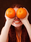 Young Girl Holding Two Oranges Stock Images