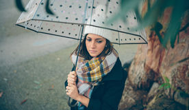 Young girl holding umbrella in an autumn rainy day Royalty Free Stock Photo