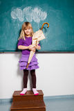 Young girl holding umbrella indoors Royalty Free Stock Image