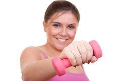 young girl holding weight for exercise Stock Image
