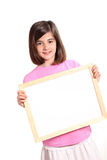 Young girl holding a white banner Stock Photo
