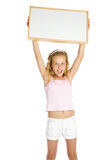 Young girl holding a white banner Royalty Free Stock Images